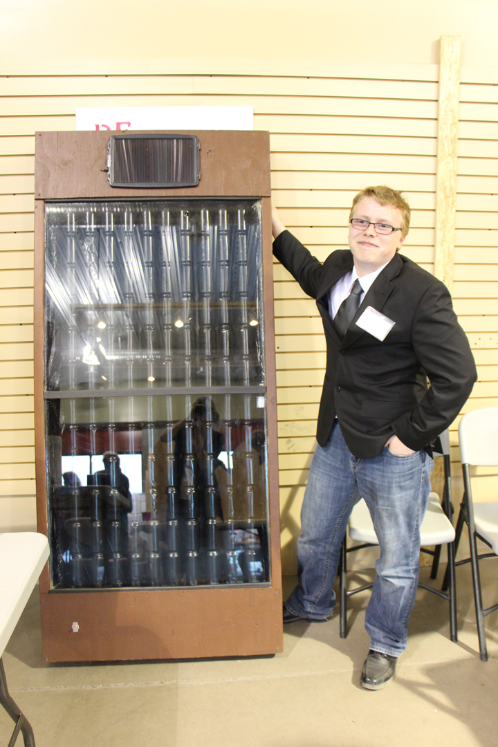 First place winner Brandon Greenall and his pop can solar heater